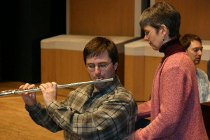 Alexander Technique teacher, Tully Hall, works with a flute player.